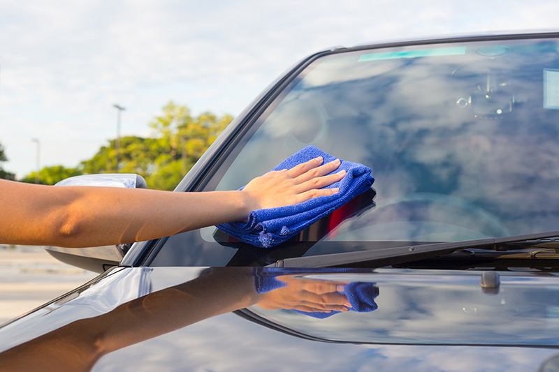 microfiber towel, car, windshield, wiping, hand