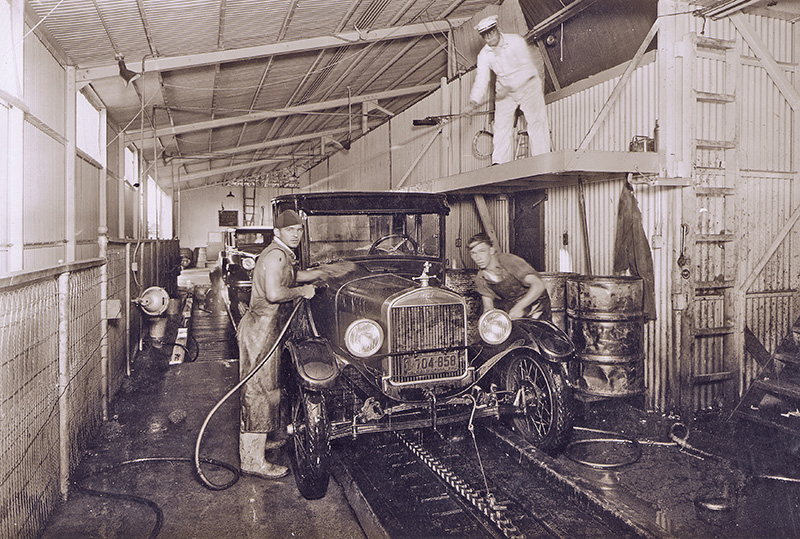 carwash history, hand washing, primitive conveyor, employees, tunnel