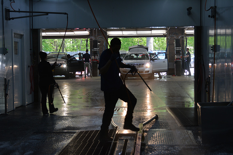 carwash tunnel, cars, car doors, hoses, employees, cleaning, hosing, detailing