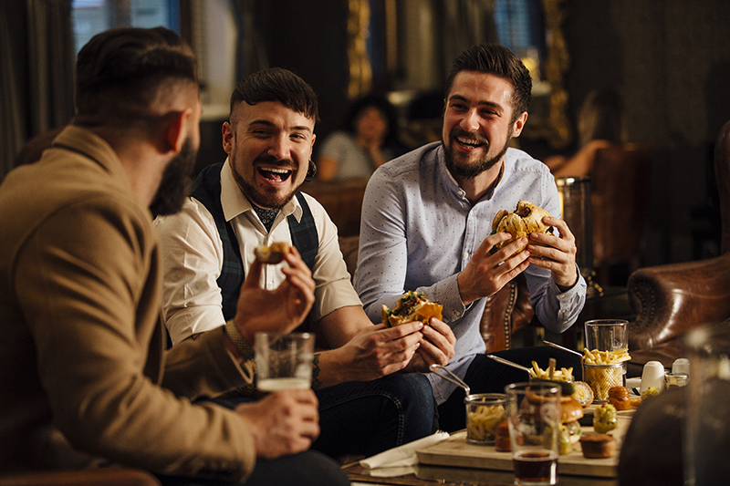 socializing, bar, millennials, laughing, talking, eating, food