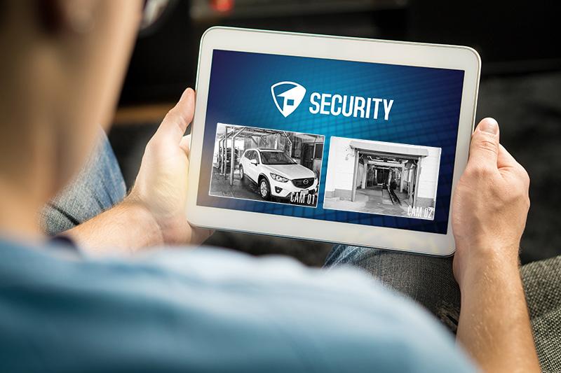 tablet, surveillance system, security footage, carwash, man