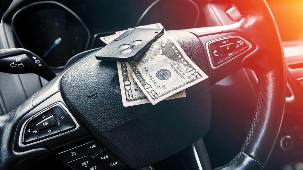 car, steering wheel, money